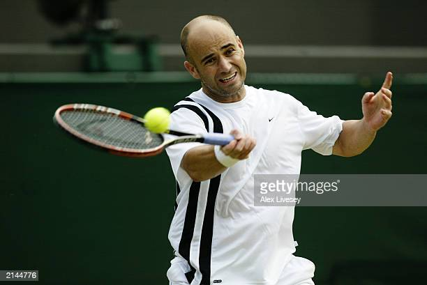 Andre Agassi of the USA plays a forehand during his victory over Lars Burgsmuller of Germany during day four of the Wimbledon Lawn Tennis...