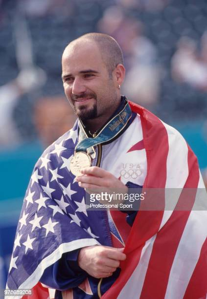 Andre Agassi of the USA poses with the gold medal whilst wearing his country's flag after defeating Sergi Bruguera of Spain in the Men's Singles Gold...