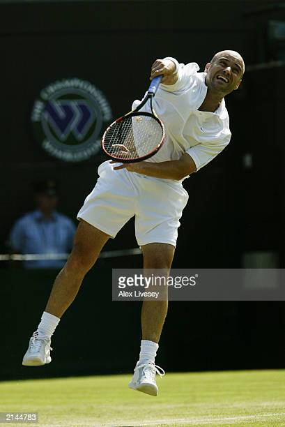 Andre Agassi of the USA serves to Lars Burgsmuller of Germany during day four of the Wimbledon Lawn Tennis Championships held on June 26 2003 at the...