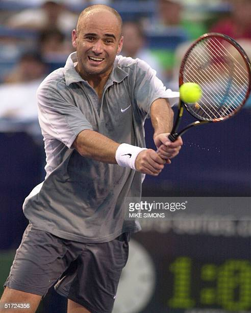Andre Agassi of the USA strikes a backhand against Gaston Gaudio of Argentina in the ATP Tennis MastersSeries Cincinnati 06 August 2001 in Cincinnati...