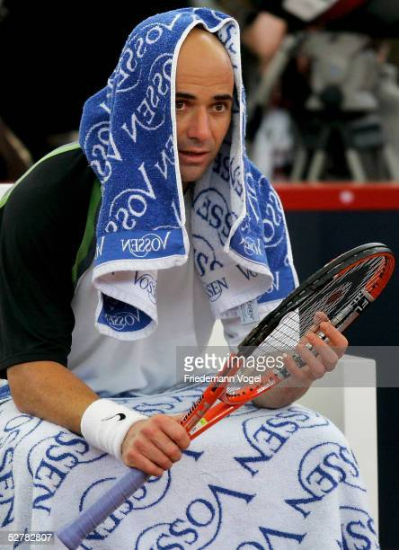 Andre Agassi of US looks dejected during his match against Feliciano Lopez of Spain during the Masters Series Hamburg at Rothenbaum on May 10 2005 in...