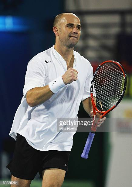 Andre Agassi of USA celebrates victory over Radic Stepanek of Czech Republic in the Dubai Duty Free Men's Open Tennis Championships on February 21...