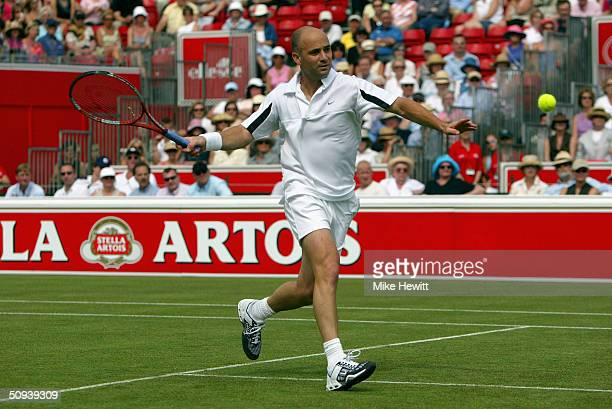 Andre Agassi of USA returns the ball during his match against Igor Andreev of Russia at the Stella Artois Tennis Tournament at the Queens Club June...
