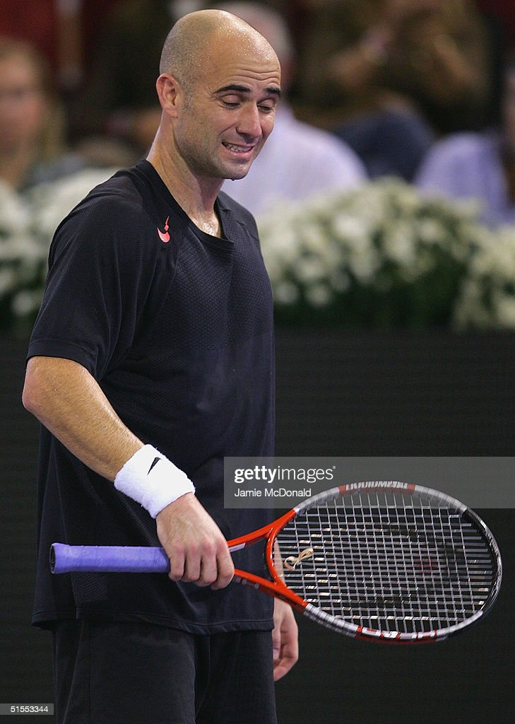 Andre Agassi of USA stands dejected after defeat in his semi final match against Marat Safin of Russia during the ATP Madrid Masters at the Nuevo Rockodromo on October 23, 2004 in Madrid, Spain.