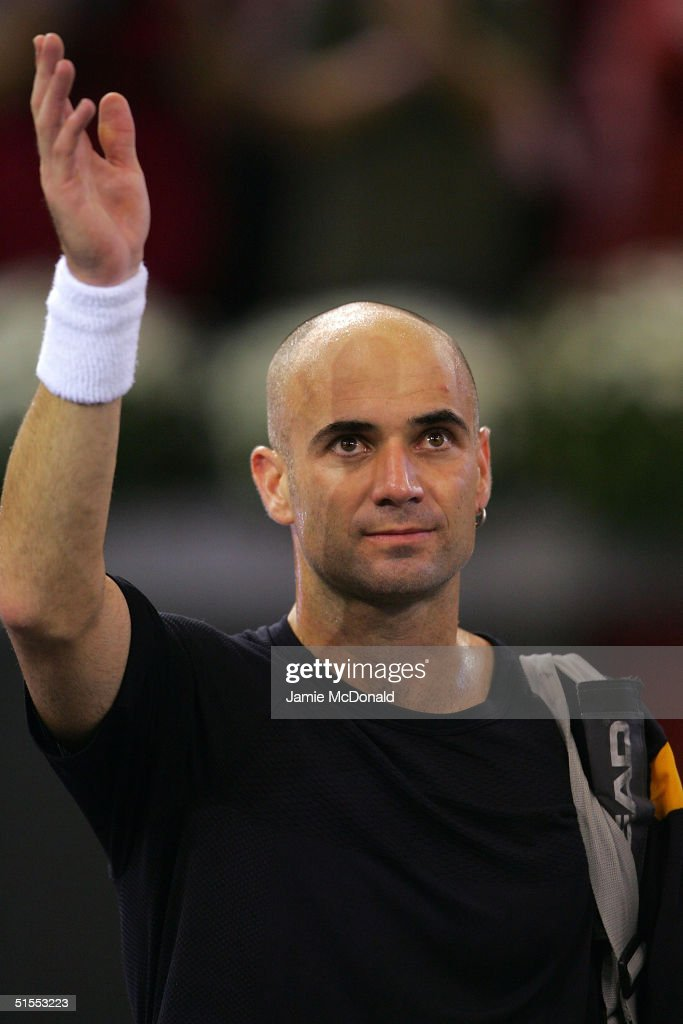 Andre Agassi of USA waves goodbye to the crowd as he looses his semi final match against Marat Safin of Russia during the ATP Madrid Masters at the Nuevo Rockodromo on October 23, 2004 in Madrid, Spain.