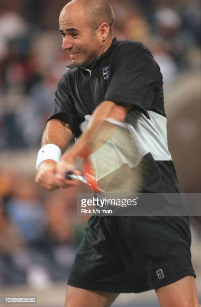 Andre Agassi playing against Swedish player Nicklas Kulti