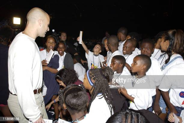 """Andre Agassi poses with children from Las Vegas youth organizations prior to The Andre Agassi Foundations's 7th """"Grand Slam for Children"""" Fundraiser..."""
