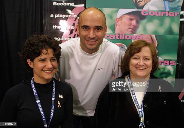 Andre Agassi poses with his sister Tami Agassi and his mother Elizabeth Agassi at the Schick XTreme III Tennis Challenge October 7 2001 at the Key...