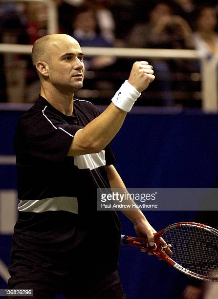 Andre Agassi pumps his fist at Mardy Fish during their semifinal match at the 2004 Siebel Open in San Jose California February 14 2004 Fish upset...