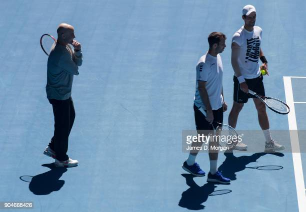 Andre Agassi Radek Stepanek and Novak Djokovic during a practice session ahead of the 2018 Australian Open at Melbourne Park on January 14 2018 in...