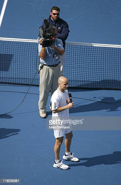 Andre Agassi reacts after losing his third round match against Benjamin Becker at the 2006 US Open at the USTA Billie Jean King National Tennis...
