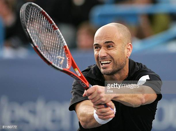 Andre Agassi returns a shot to Andy Roddick in the first set during the Western and Southern Financial Group Masters on August 7 2004 at the Lindner...