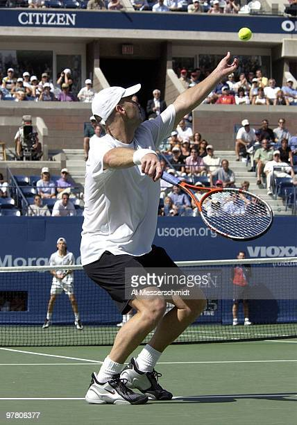 Andre Agassi serves for match point during a three-set, quarter final victory over Guillermo Coria Friday on September 5, 2003 at the U. S. Open.