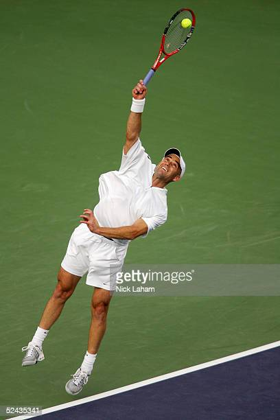 Andre Agassi serves to Guillermo Coria of Argentina during the Pacific Life Open at the Indian Wells Tennis Garden on March 16, 2005 in Indian Wells,...