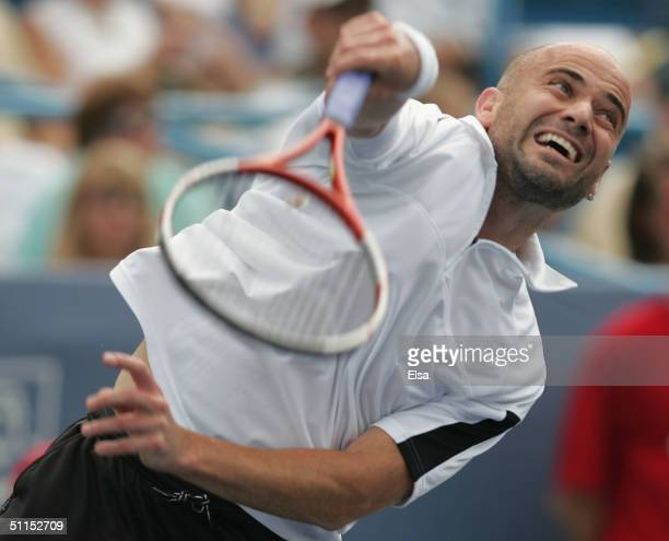 Andre Agassi serves to Lleyton Hewitt of Australia in the championship match during the Western and Southern Financial Group Masters on August 8 2004...