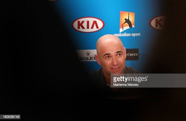 Andre Agassi talks to the press during day twelve of the 2013 Australian Open at Melbourne Park on January 25 2013 in Melbourne Australia