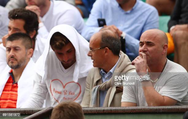 Andre Agassi the coach of Novak Djokovic of Serbiia watches his men's singles third round match against Diego Schwartzman of Argentina on day six of...