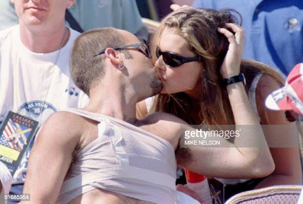 Andre Agassi the world's top ranked tennis player gets a kiss from his actress/model girlfriend Brooke Shields as he sits at courtside watching the...