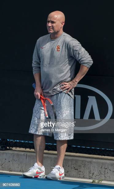 Andre Agassi watches his player Novak Djokovic during practice on day six of the 2018 Australian Open at Melbourne Park on January 20 2018 in...