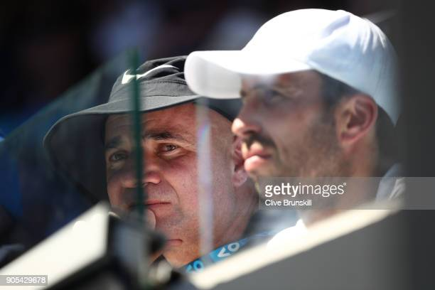 Andre Agassi watches the first round match between Novak Djokovic of Serbia and Donald Young of the United States on day two of the 2018 Australian...
