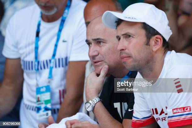 Andre Agassi watches the second round match between Novak Djokovic of Serbia and Gael Monfils of France on day four of the 2018 Australian Open at...