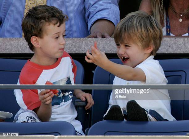 Andre Agassi's son Jaden Agassi right laughs with another child as his dad competes in the fourth round against Xavier Malisse of Belgium during the...