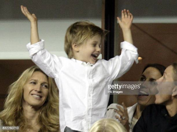 Andre Agassi's son Jaden Gil celebrates with his mother Steffi Graf after USA's Andre Agassi beat Marcos Baghdatis in their second round match at the...