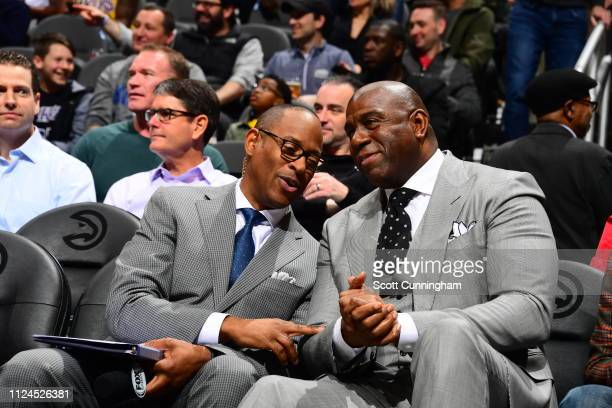 Andre Aldridge and Magic Johnson are seen talking together during the game between the Atlanta Hawks and the Los Angeles Lakers on February 12 2019...