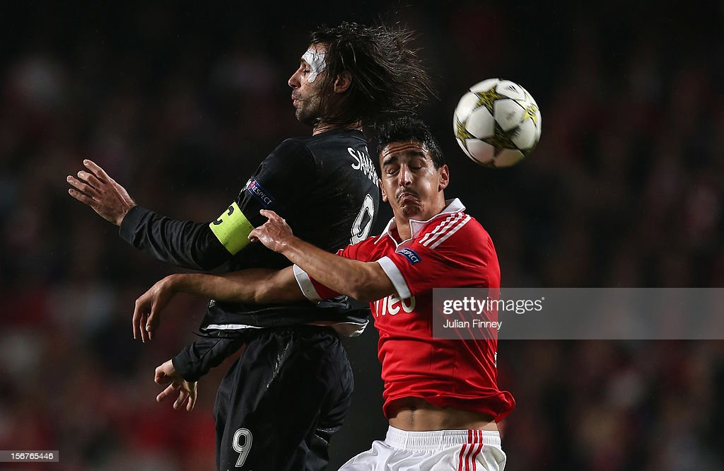 Andre Almeida of Benfica challenges for the ball in the air with Georgios Samaras of Celtic during the UEFA Champions League, Group G match between SL Benfica and Celtic FC at Estadio da Luz on November 20, 2012 in Lisbon, Portugal.