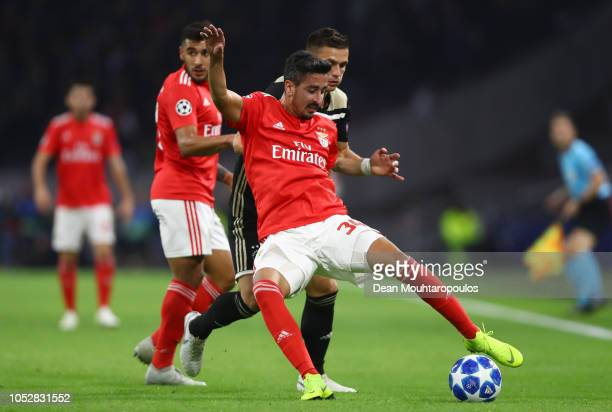 Andre Almeida of Benfica is challenged by Dusan Tadic of Ajax during the Group E match of the UEFA Champions League between Ajax and SL Benfica at...