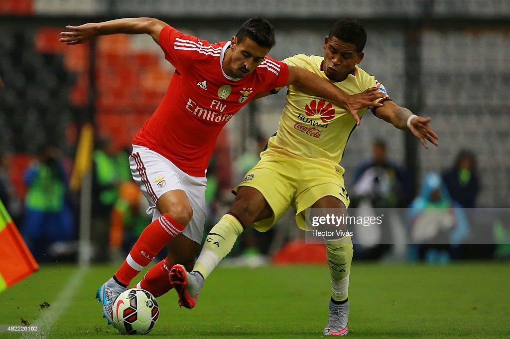 Andre Almeida of Benfica (L) struggles for the ball with Michael Arroyo of America (R) during a match between America and Benfica as part of the International Champions Cup 2015 at Azteca Stadium on July 28, 2015 in Mexico City, Mexico.