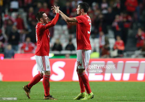 Andre Almeida of SL Benfica celebrates with teammate Andrija Zivkovic of SL Benfica after scoring a goal during the Liga NOS match between SL Benfica...