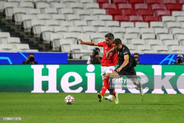 Andre Almeida of SL Benfica vies with Lucas Hernandez of FC Bayern Munchen during the UEFA Champions League group E match between SL Benfica and...