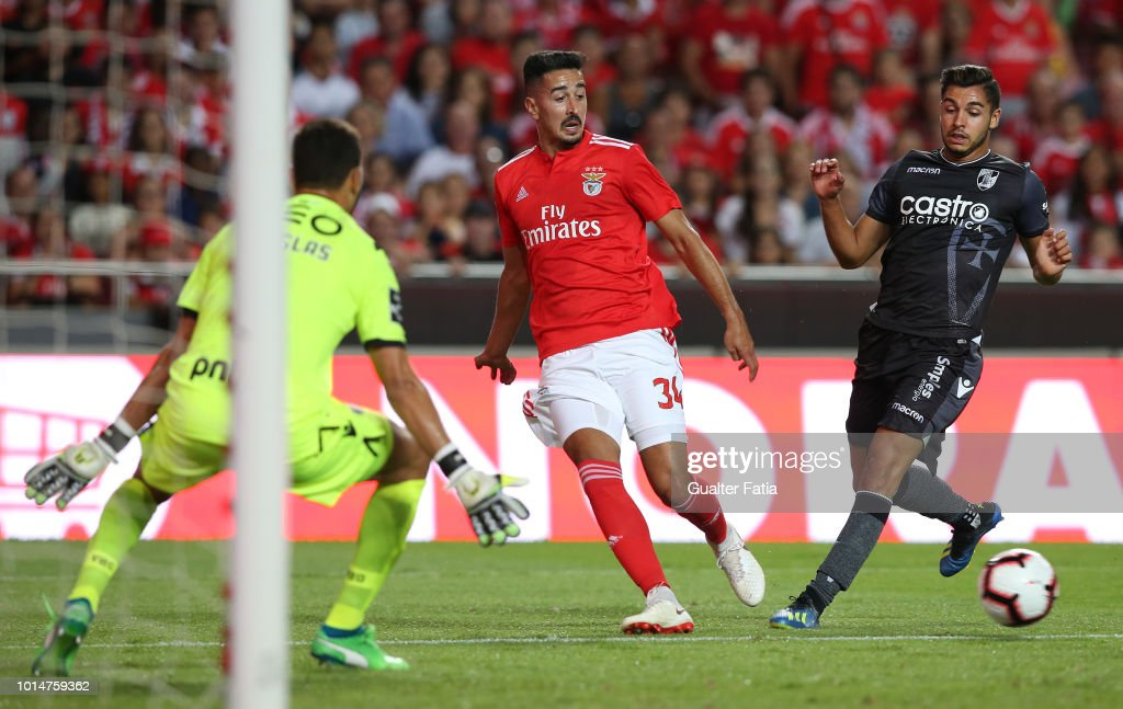Andre Almeida of SL Benfica with Rafa Soares of Vitoria SC in action during the Liga NOS match between SL Benfica and Vitoria SC at Estadio da Luz on August 10, 2018 in Lisbon, Portugal.