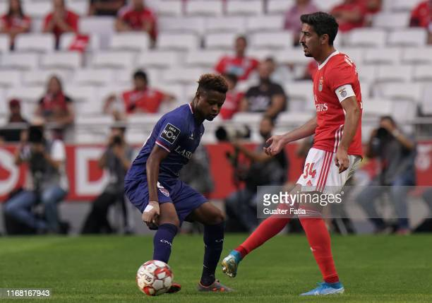 Andre Almeida of SL Benfica with Yves Baraye of Gil Vicente FC in action during the Liga NOS match between SL Benfica and Gil Vicente FC at Estadio...
