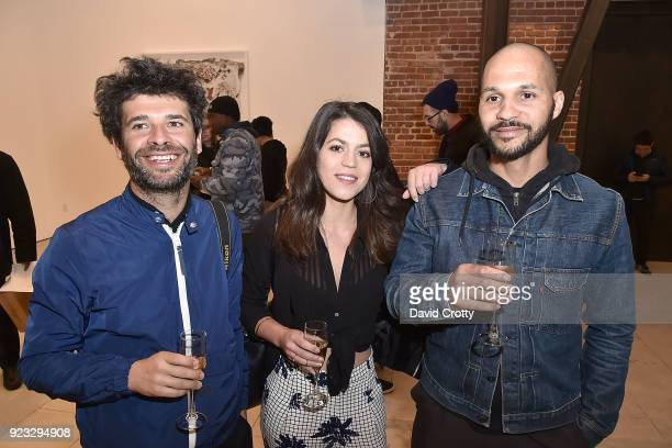 Andre Alves Marlene Mendes and Paolo Paedade attend the Vhils 'Annihilation' Opening Reception on February 22 2018 in Los Angeles California