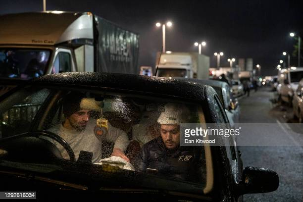 Andre and Constanti from Romania wait in their car at the entry to the port on December 22, 2020 in Dover, England. Over 1000 lorries remained...