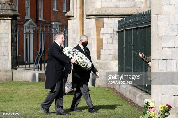 Andre and Stan Walker carry a wreath to lay at the gates of Windsor Castle in Windsor, west of London, on April 16, 2021 on the eve of the funeral of...