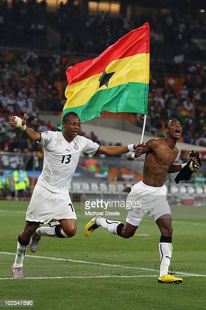 Andre Ayew and John Pantsil of Ghana celebrate qualifying for the last sixteen during the 2010 FIFA World Cup South Africa Group D match between...