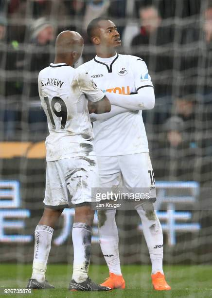 Andre Ayew and Jordan Ayew of Swansea City celebrate their side's fourth goal during the Premier League match between Swansea City and West Ham...