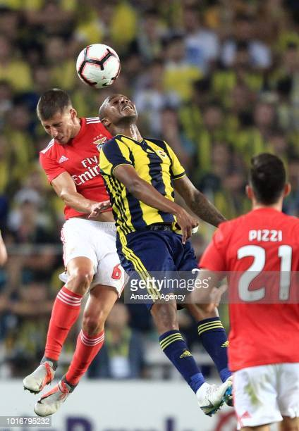 Andre Ayew of Fenerbahce in action against Ruben Dias of Benfica during UEFA Champions League third qualifying round's second leg match between...
