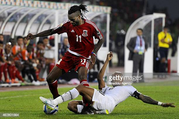 Andre Ayew of Ghana competes for the ball with Javier Balboa of Equatorial Guinea during the 2015 African Cup of Nations semifinal football match...