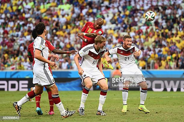 Andre Ayew of Ghana scores his team's first goal on a header over Per Mertesacker and Shkodran Mustafi of Germany during the 2014 FIFA World Cup...