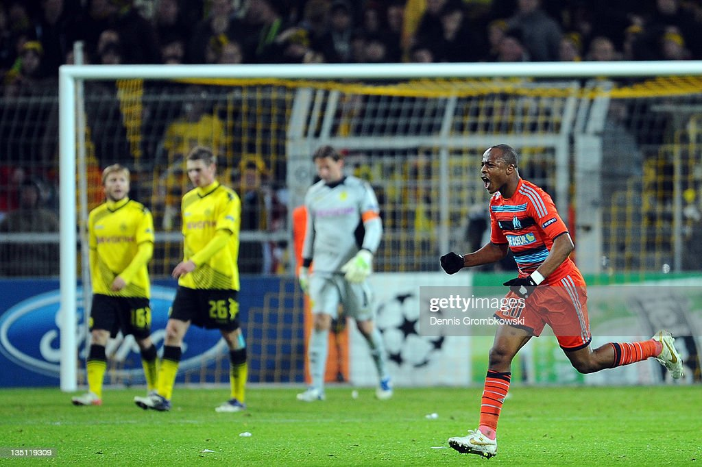 Andre Ayew (R) of Marseille celebrates after scoring his team's second goal during the UEFA Champions League group F match between Borussia Dortmund and Olympique de Marseille at Signal Iduna Park on December 6, 2011 in Dortmund, Germany.