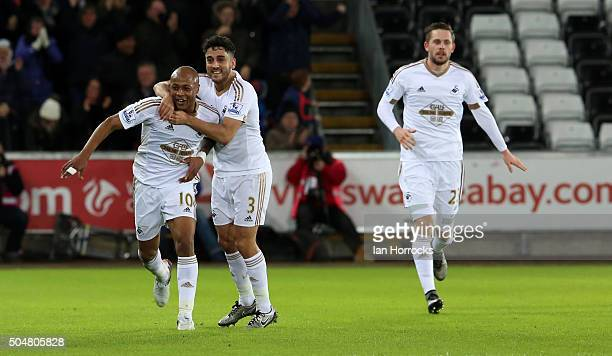 Andre Ayew of Swansea celebrates after scoring the second Swansea goal with Neil Taylor during the Barclays Premier League Match between Swansea City...