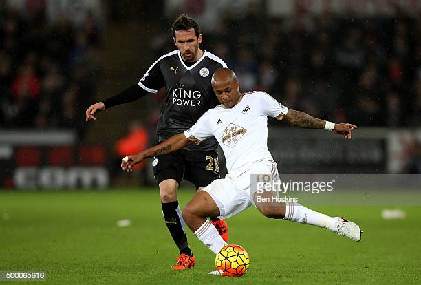 Andre Ayew of Swansea City and Christian Fuchs of Leicester City compete for the ball during the Barclays Premier League match between Swansea City...