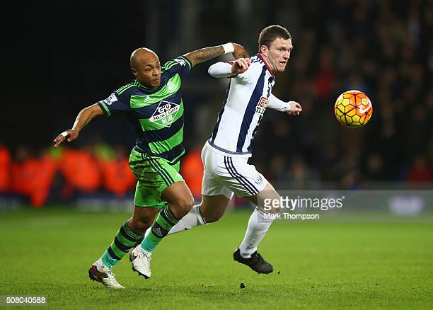 Andre Ayew of Swansea City and Craig Gardner of West Bromwich Albion compete for the ball during the Barclays Premier League match between West...