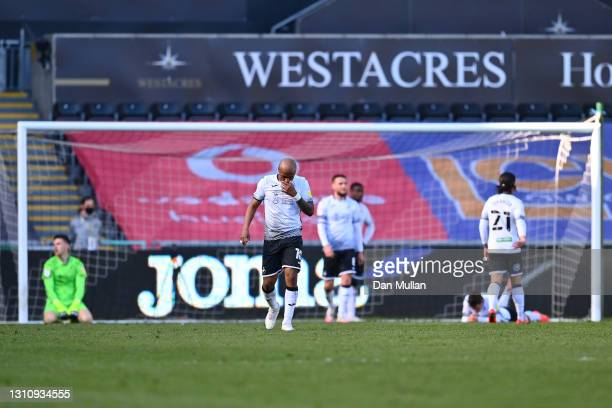 Andre Ayew of Swansea City and his teammates react after conceding their first goal during the Sky Bet Championship match between Swansea City and...