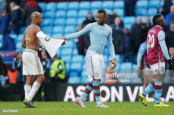 Andre Ayew of Swansea City and Jordan Ayew of Aston Villa shake hands after the Barclays Premier League match between Aston Villa and Swansea City at...