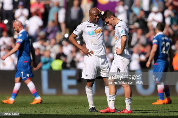 Andre Ayew of Swansea City and Tom Carroll of Swansea City dejected at full time after relegation is confirmed from the Premier league during the...